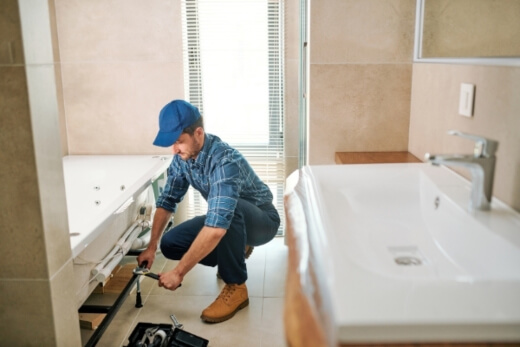 An electrician doing bathroom renovation